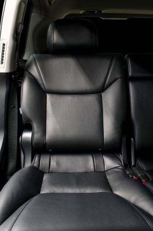 Rear passenger leather seat. Car interior. photo