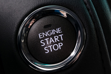Car engine start and stop button. Interior detail. photo