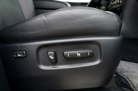 adjusting: Buttons for adjusting seat position. Car interior. Stock Photo