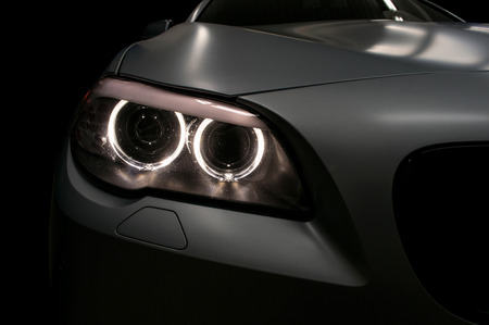front bumper: Car headlights. Exterior detail. Stock Photo