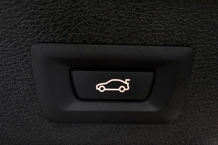 car trunk: Car trunk closing button. Auto detail interior.