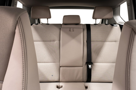 Back passenger seats in modern car. Interior detail.