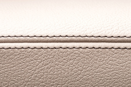 Car interior leather texture. Horizontal photo.