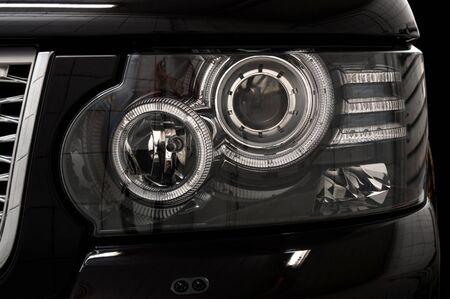 headlights: Black car headlights. Exterior detail. Stock Photo