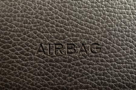 Слово подушки написано на приборной панели автомобиля. Интерьер деталь. Фото со стока