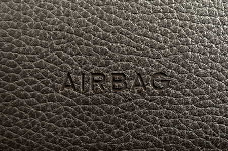 Word Airbag written on car dashboard. Interior detail. Stock Photo