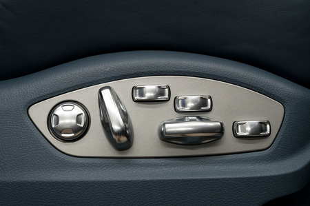 Buttons for adjusting car seat position