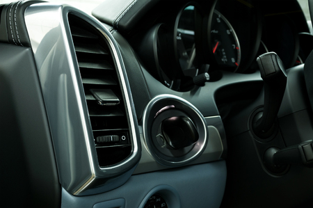 Modern car air conditioning system. Auto interior detail.