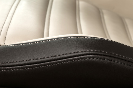 car detail: Detail of leather car seat. Horizontal photo. Stock Photo