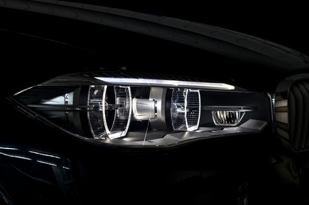 Modern car headlight with backlight. Exterior detail.