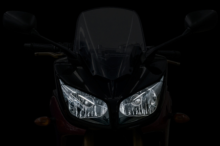 Modern motorcycle head light with two bulbs. Banco de Imagens