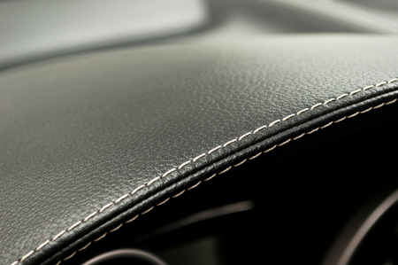 Leather background. Modern business car interior detail. Stock Photo