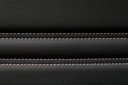 car detail: Leather background. Modern business car interior detail. Stock Photo