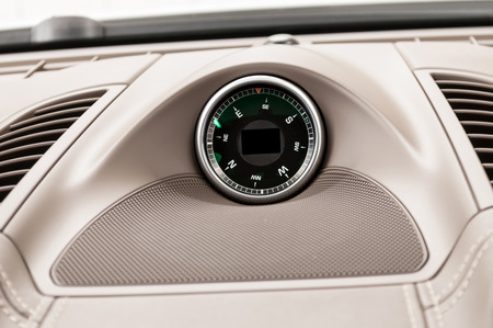 car navigation: Car dashboard compass. Interior detail.