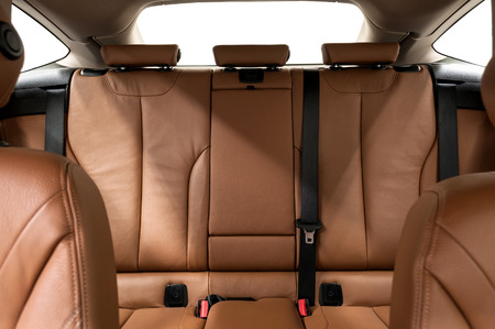 Leather back passenger seats in modern car. Interior detail. photo