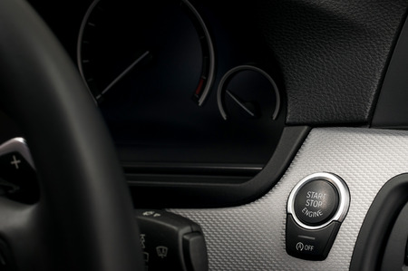 Modern car engine start and stop button. Interior detail. Banco de Imagens