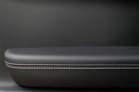 saddler: Automobile leather door panel. Interior detail. Stock Photo