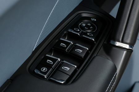 Car window control and adjustment buttons. Interior details.