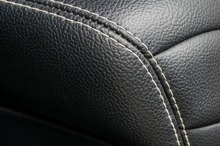 saddler: Modern business car interior detail. Leather background.