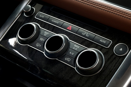 Car climate control panel. Interior detail.