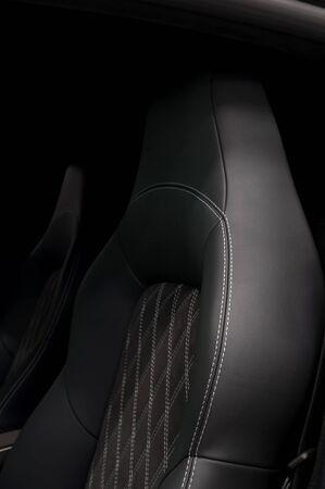 suede belt: Leather car seats. Interior detail. Vertical photo.