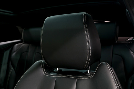 Modern car leather headrest. Interior detail.