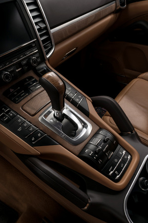 Luxury automatic car transmission control buttons and gear lever. Interior detail. Banco de Imagens