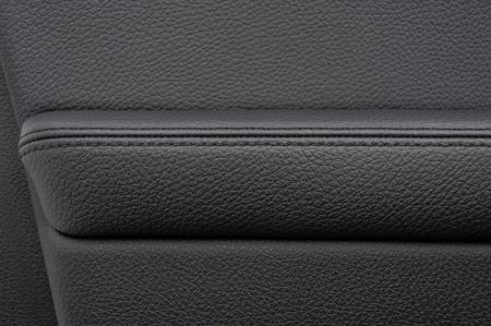 saddler: Leather  background. Auto door armrest. Modern business car interior detail. Stock Photo