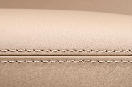 saddler: Business car interior detail. Piece of furniture. Leather background. Stock Photo