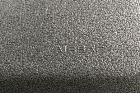car inside: Word Airbag on car plastic dashboard. Interior detail. Stock Photo