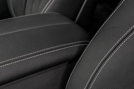 saddler: Detail of leather car interior. Leather background.