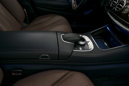 Luxury car interior background. Dashboard control buttons.