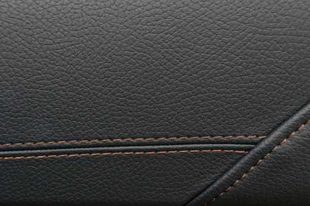 Modern business car interior detail. Leather background.