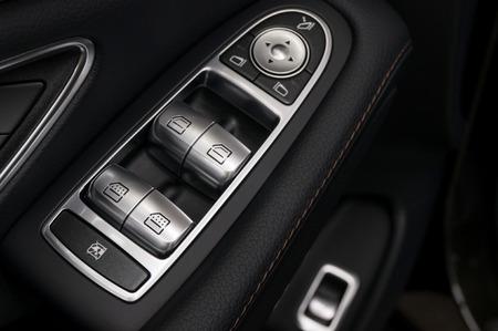 Business car window control buttons. Interior details.