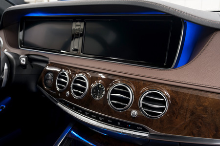 Modern car dashboard. Air conditioning system. Interior detail.