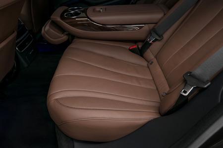 suede belt: Business car interior background. Rear passenger leather seat.