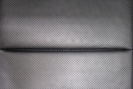 saddler: Leather background. Modern business car perforated leather seat. Interior detail.