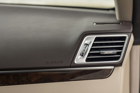 air hole: Car dashboard. Airbag panel and air conditioning hole. Interior detail. Stock Photo