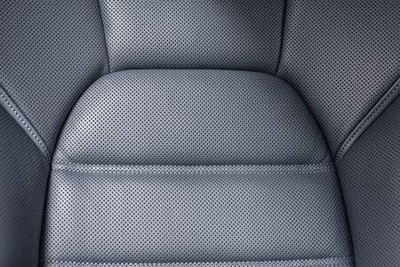 saddler: Detail of modern business car perforated leather seat.