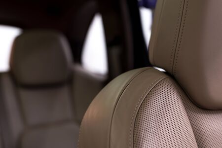 nervure: Detail of leather car seats.