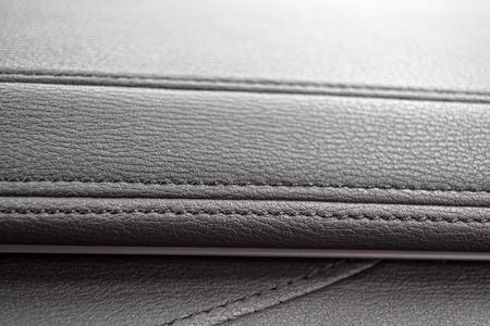 saddler: Car leather dashboard detail. Stock Photo