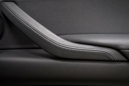 saddler: Car leather door handle. Interior detail. Stock Photo