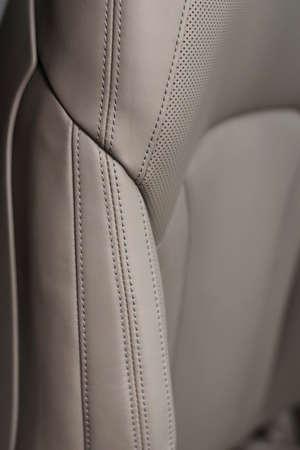 saddler: Leather background. Car seat detail.