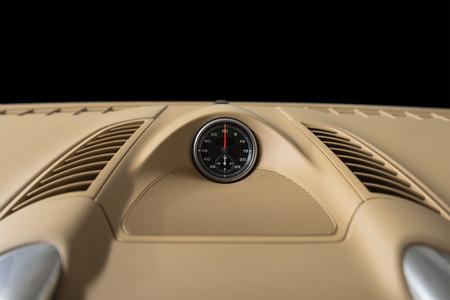 Sport car interior detail. Dashboard stopwatch.