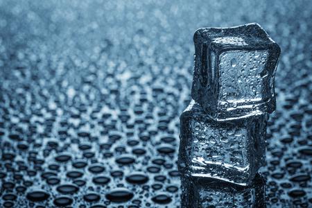 Wet ice cubes. Studio photo. Stock Photo