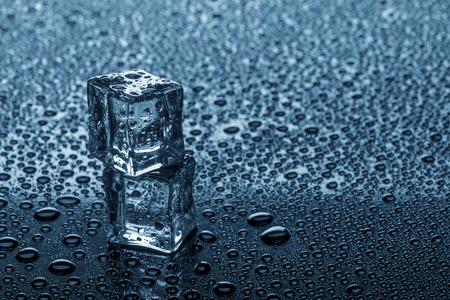Wet ice cubes on glossy background. Horizontal studio photo. Stock Photo