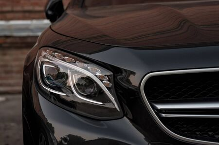 Business, luxury car headlights. Exterior detail.