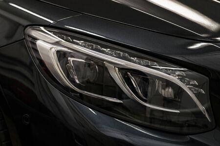 Luxury car headlights. Exterior detail.