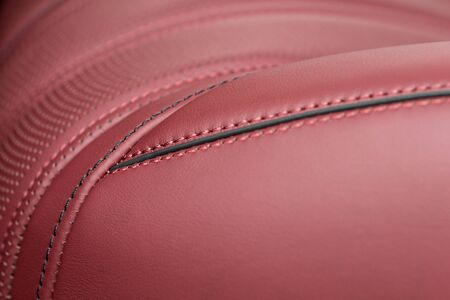 Part of car leather seat with stitch. Interior details.