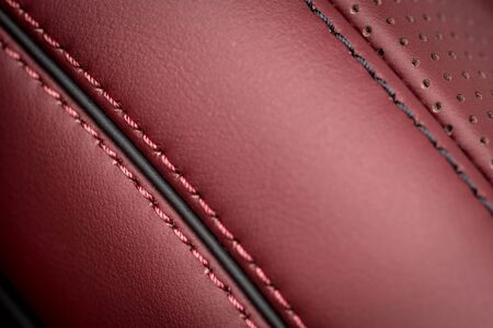 Car leather background with stitch. Interior detail.